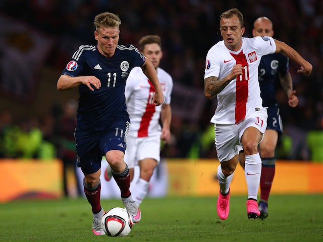 Matt Ritchie of Scotland takes on Kamil Grosicki of Poland during the EURO 2016 Qualifier between Scotland and Poland at Hamden Park on October 8, 2015 in Glasgow, Scotland.