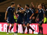 Matt Ritchie of Scotland celebrates with Steven Fletcher of Scotland after he scores during the UEFA EURO 2016 qualifier between Scotland and Poland at Hampden Park on October 08, 2015 in Glasgow, Scotland.