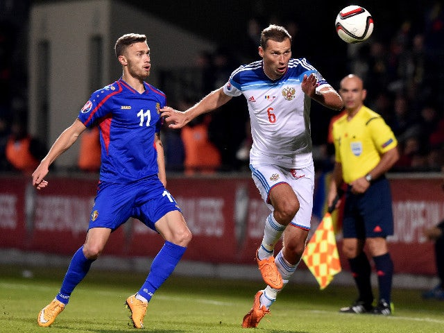 Russia's defender Aleksei Berezutski (R) vies Moldova's forward Nicolae Milinceanu during the Euro 2016 qualifying football match between Russia and Moldova at the Stadionul Zimbru in Chisinau on October 9, 2015.