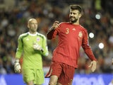 Defender Gerard Pique (R) grimaces during the Euro 2016 qualifying football match Spain vs Luxembourg at Las Gaunas stadium in Logrono on October 9, 2015
