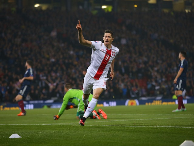 Robert Lewandowski of Poland celebrates after scoring the opening goal during the UEFA EURO 2016 qualifier between Scotland and Poland at Hampden Park on October 08, 2015 in Glasgow, Scotland.