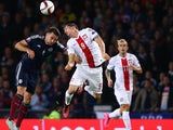 Russell Martin of Scotland is challenged by Robert Lewandowski of Poland during the EURO 2016 Qualifier between Scotland and Poland at Hamden Park on October 8, 2015 in Glasgow, Scotland.
