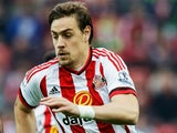 Sebastian Coates of Sunderland and Diafra Sakho of West Ham United compete for the ball during the Barclays Premier League match between Sunderland and West Ham United at the Stadium of Light in Sunderland, United Kingdom