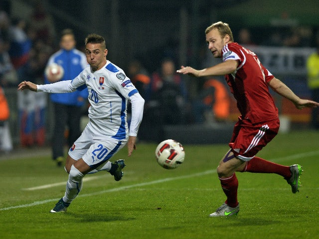 Slovakia's Robert Mak (L) and Belarus' Maksim Bordachev vie for the ball during the Euro 2016 Group C qualifying football match between Slovakia and Belarus in Zilina, Slovakia on October 9, 2015.
