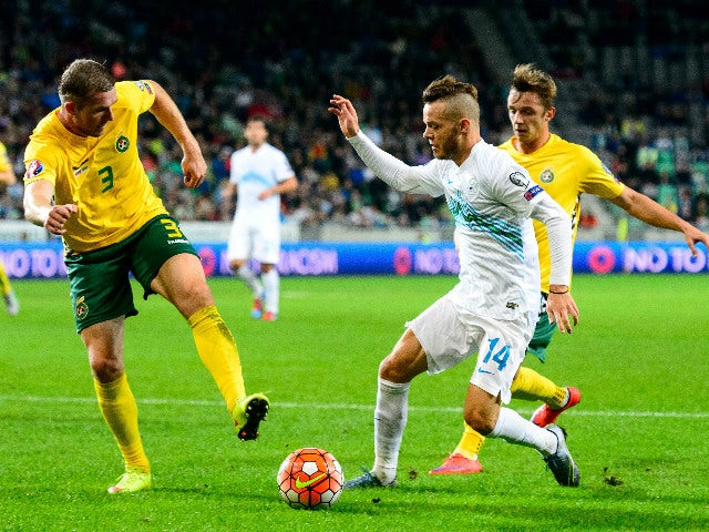 Slovenia's Dejan Lazarevic (C) vies with Lithuania's Georgas Freidgeimas (L) during the Euro 2016 Group E qualifying football match between Slovenia and Lithuania at the Stozice stadium in Ljubljana, Slovenia on October 9, 2015.