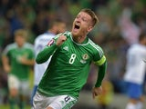 Steve Davis of Northern Ireland celebrates after scoring his side's third goal against Greece during the UEFA EURO 2016 qualifier between Northern Ireland and Greece at Windsor Park on October 8, 2015 in Belfast, Northern Ireland.