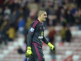 Sunderland's Italian goalkeeper Vito Mannone leaves the field at the final whistle during the English League Cup third round football match between Sunderland and Manchester City at the Stadium of Light in Sunderland, northest England, on September 22, 20