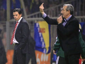 Head coach Chris Coleman (L) of Wales looks at head coach Mehmed Bazdarevic (R) of Bosnia during the Euro 2016 qualifying football match between Bosnia and Herzegovina and Wales at the Stadium Bilino Polje in Elbasan on October 10, 2015.