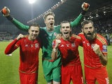 Players of Wales national team (L-R) Aaron Ramsey, goalkeeper Almuth Schult, Gareth Bale and David Vaughan celebrate the Euro 2016 qualifying football match between Bosnia and Herzegovina and Wales at the Stadium Bilino Polje in Elbasan on October 10, 201