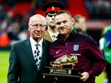 Wayne Rooney of England is presented with the Golden Boot by Sir Bobby Charlton after breaking his record of 49 goals prior to the UEFA EURO 2016 Group E qualifying match between England and Estonia at Wembley on October 9, 2015 in London, United Kingdom.