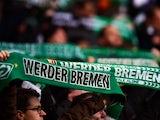 Bremen's fans wave with scarves prior to the German first division Bundesliga football match SV Werder Bremen vs VfL Wolfsburg in Bremen, western Germany, on March 1, 2015.