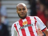 Younes Kaboul of Sunderland clears the ball from Harry Kane of Tottenham Hotspur during the Barclays Premier League match between Sunderland and Tottenham Hotspur at the Stadium of Light on September 13, 2015 in Sunderland, United Kingdom.