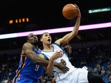 Zach LaVine #8 of the Minnesota Timberwolves shoots the ball as Serge Ibaka #9 of the Oklahoma City Thunder reaches over for a foul during the third quarter of the preseason game on October 7, 2015 at Target Center in Minneapolis, Minnesota.