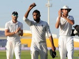 Adil Rashid of England salutes the crowd as he leaves the field after claiming 5 wicket haul during day five of the 1st Test between Pakistan and England at Zayed Cricket Stadium on October 17, 2015