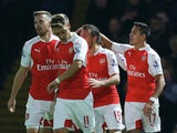 Alexis Sanchez of Arsenal (R) celebrates with team mates as he scores their first goal during the Barclays Premier League match between Watford and Arsenal at Vicarage Road on October 17, 2015 in Watford, England.