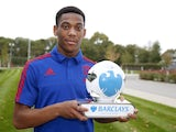 Anthony Martial poses with his Player of the Month award for September 2015
