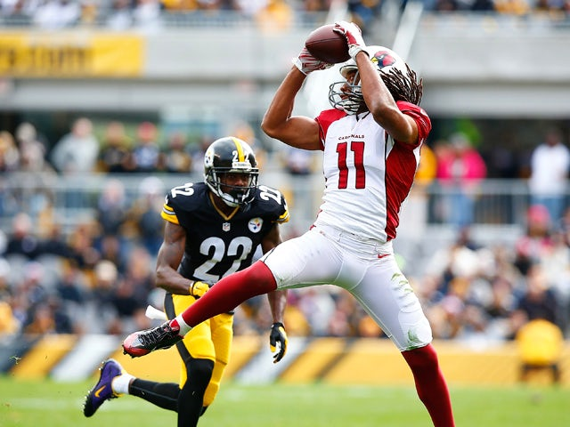 Larry Fitzgerald #11 of the Arizona Cardinals catches a pass in front of William Gay #22 of the Pittsburgh Steelers during the 1st quarter of the game at Heinz Field on October 18, 2015