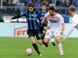 Marten De Roon of Atalanta BC competes for the ball with Andrea Lazzari of Carpi FC during the Serie A match between Atalanta BC and Carpi FC at Stadio Atleti Azzurri d'Italia on October 18, 2015 in Bergamo, Italy.