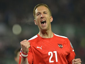 Austria end qualification with win