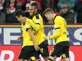 Dortmund's striker Marco Reus (R) celebrates with teammates Dortmund's Gabonese striker Pierre-Emerick Aubameyang (C) and Dortmund's Japanese midfielder Shinji Kagawa (L) after scoring the 0-1 during the German first division Bundesliga football match FSV