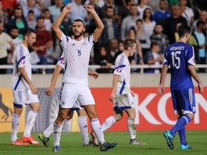 Bosnia and Herzegovina's Haris Medunjanin celebrates after scoring a goal during the Euro 2016 qualifying football match against Cyprus on October 13, 2015