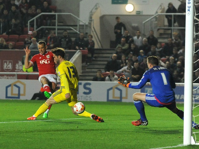 Aaron Wilbraham of Bristol City scores his sides first goal during the Sky Bet Championship match between Bristol City and Nottingham Forest at Ashton Gate on October 16, 2015 in Bristol, England.
