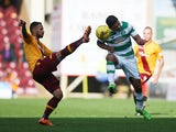 Lionel Ainsworth of Motherwell vies with Emilio Izaguirre of Celtic during the Ladbrokes Scottish Premiership match between Motherwell and Celtic at Fir Park on October 17, 2015