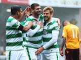 Nadir Ciftci of Celtic celebrates scoring with Stuart Armstrong of Celtic during the Ladbrokes Scottish Premiership match between Motherwell and Celtic at Fir Park on October 17, 2015