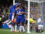 Chelsea players celebrate their team's first goal by Diego Costa (obscured) during the Barclays Premier League match between Chelsea and Aston Villa at Stamford Bridge on October 17, 2015