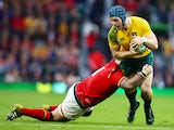 Paul James of Wales tackles David Pocock of Australia during the Rugby World Cup 2015 Pool A match between Australia and Wales at Twickenham Stadium on October 10, 2015