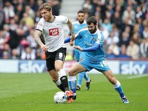 Martin brace fires Derby past Wolves