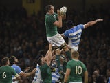 Ireland's lock Devin Toner (L) catches the ball in a line out against Argentina's lock Tomas Lavanini (R) during a quarter final match of the 2015 Rugby World Cup between Ireland and Argentina at the Millennium Stadium in Cardiff, south Wales, on October