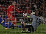Wales's midfielder Aaron Ramsey scores a goal past Andorra's goalkeeper Ferran Pol Perez during the Euro 2016 qualifying football match between Wales and Andorra at Cardiff City stadium in Cardiff, south Wales, on October 13, 2015.