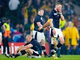 Finn Russell of Scotland reacts with team mates after the 2015 Rugby World Cup Quarter Final match between Australia and Scotland at Twickenham Stadium on October 18, 2015