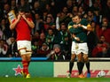 Fourie Du Preez of South Africa is congratulated by Bryan Habana of South Africa for scoring the winning try as Captain Sam Warburton of Wales looks dejected during the 2015 Rugby World Cup Quarter Final match between South Africa and Wales at Twickenham