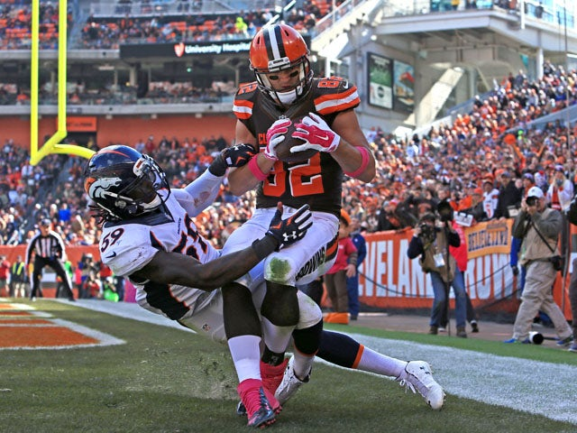 Tight end Gary Barnidge #82 of the Cleveland Browns catches a pass for a touchdown while being defended by inside linebacker Danny Trevathan #59 of the Denver Broncos during the third quarter at Cleveland Browns Stadium on October 18, 2015