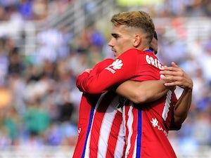 Atletico beat Malaga to go third