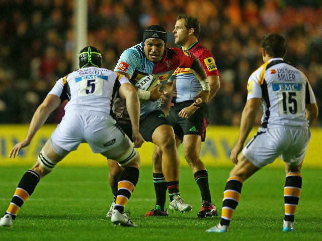 Mat Luamanu of Harlequins takes on the Wasps defence during the Aviva Premiership match between Harlequins and Wasps at Twickenham Stoop on October 16, 2015 in London, England.