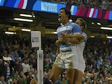 Argentina's centre Matias Moroni (L) celebrates after scoring the first try during a quarter final match of the 2015 Rugby World Cup between Ireland and Argentina at the Millennium Stadium in Cardiff, south Wales, on October 18, 2015.