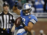 Lance Moore #16 of the Detroit Lions celebrates a first quarter touchdown against the Chicago Bears at Ford Field on October 18, 2015
