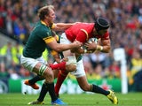 Luke Charteris of Wales is tackled by Adriaan Strauss of South Africa and Handre Pollard of South Africa during the 2015 Rugby World Cup Quarter Final match between South Africa and Wales at Twickenham Stadium on October 17, 2015