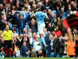 Raheem Sterling of Manchester City celebrates scoring his team's fourth and hat trick goal during the Barclays Premier League match between Manchester City and A.F.C. Bournemouth at Etihad Stadium on October 17, 2015