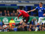 Wayne Rooney of Manchester United scores his team's third goal during the Barclays Premier League match between Everton and Manchester United at Goodison Park on October 17, 2015