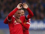 Wayne Rooney of Manchester United celebrates scoring his team's third goal with his team mate Jesse Lingard during the Barclays Premier League match between Everton and Manchester United at Goodison Park on October 17, 2015