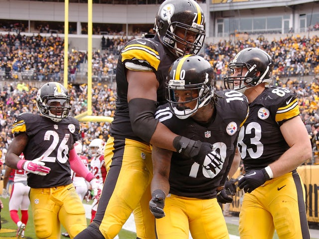 Marcus Gilbert #77 and Martavis Bryant #10 of the Pittsburgh Steelers celebrate Bryant's a 3rd quarter touchdown during the game against the Arizona Cardinals at Heinz Field on October 18, 2015