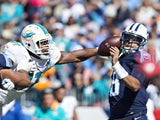 Marcus Mariota #8 of the Tennessee Titans has the ball knocked loose by Cameron Wake #91 of the Miami Dolphins at LP Field on October 18, 2015