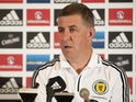 Assistant manager of Scotland Mark McGhee talks to the media during the Scotland Press Conference at Sopwell House ahead of the friendly match against England on August 12, 2013