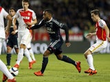 Lyon's French forward Alexandre Lacazette vies with Monaco's Croatian midfielder Mario Pasalic (R) during the French L1 football match between Monaco (ASM) and Lyon (OL) on October 16, 2015 at the Louis II Stadium in Monaco