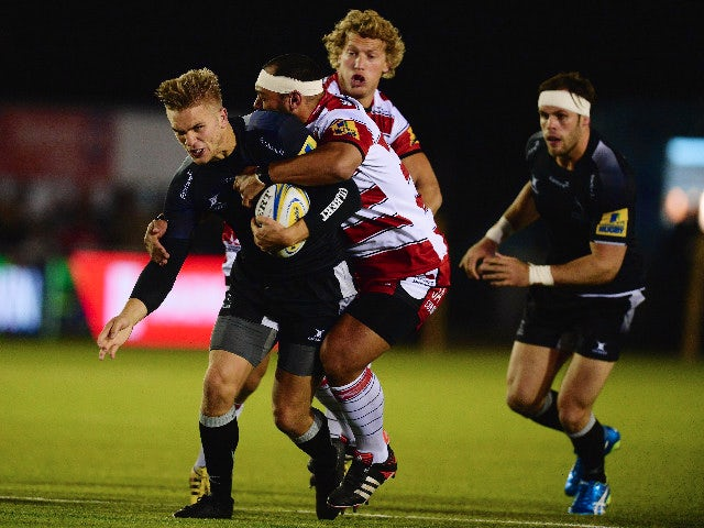 Chris Harris (L) of Newcastle Falcons tackled by John Afoa of Gloucester during the Aviva Premiership match between Newcastle Falcons and Gloucester at Kingston Park on October 16, 2015 in Newcastle upon Tyne, England.