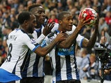 Newcastle United's Dutch midfielder Georginio Wijnaldum (R) celebrates with Newcastle United's Dutch midfielder Vurnon Anita (L) and Newcastle United's French defender Massadio Haidara (2nd L) after scoring his fourth goal, Newcastle's sixth, during the E